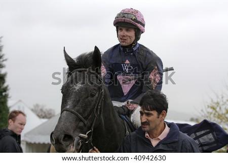 CHELTENHAM, GLOUCS; NOV 14: jockey Sam Thomas returns from riding Olofi in the first race at Cheltenham Racecourse, UK, November 14, 2009 in Cheltenham, Gloucs - stock photo