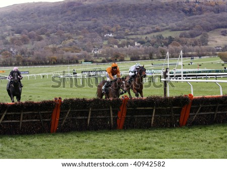 CHELTENHAM, GLOUCS; NOV 14: jockeys daryl jacobs and a p mccoy battle to win in the first race at Cheltenham Racecourse, UK, November 14, 2009 in Cheltenham, Gloucs - stock photo