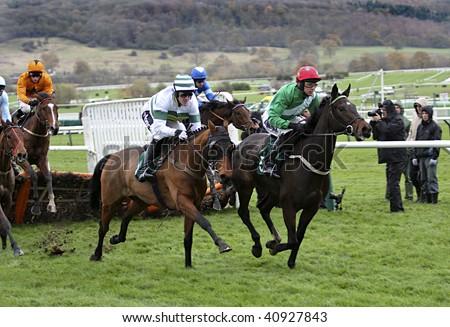 CHELTENHAM, GLOUCS; NOV 14:  jockeys Tony McCoy and Paddy Brennan battle for supremacy in the first race at Cheltenham Racecourse, UK, 14th November 2009 in Cheltenham, Gloucs - stock photo