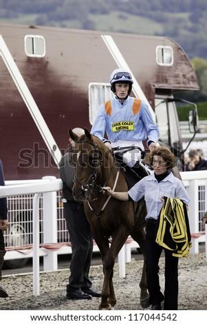 CHELTENHAM, GLOUCS, OCT 2012: jockey Sam Twiston-Davies returns from the second race with Mad Moose, Cheltenham Racecourse, Cheltenham UK, 20 October 2012 - stock photo