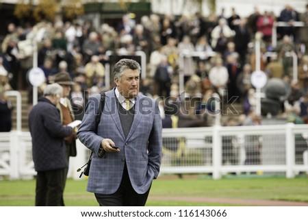 CHELTENHAM, GLOUCS, OCT 19 2012; trainer Paul Nicholls in the parade ring at Cheltenham Racecourse, Cheltenham UK Oct 19 2012 - stock photo