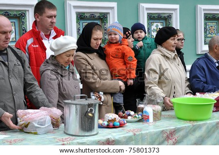 CHELYABINSK - APRIL 23: Church ceremony of consecration of Easter cakes and eggs for Easter Christ's in Russia .April 23, 2011, Chelyabinsk, Russia. Unidentified children and people - stock photo