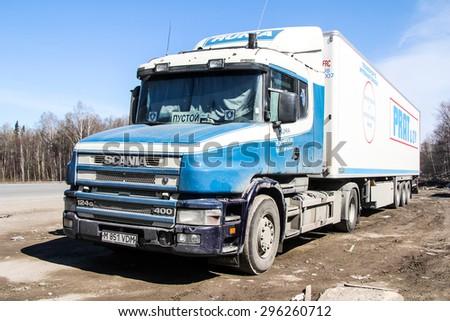 CHELYABINSK REGION, RUSSIA - APRIL 14, 2012: Semi-trailer truck Scania T400 at the interurban road. - stock photo