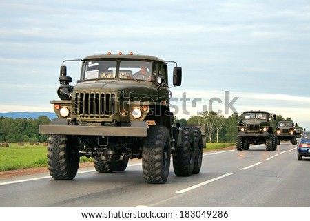 CHELYABINSK REGION, RUSSIA - AUGUST 29, 2008: Russian military trucks URAL 4320 at the interurban road. - stock photo