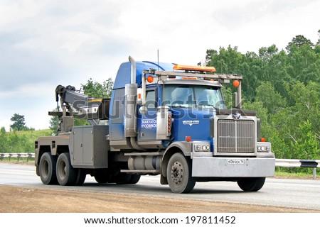 CHELYABINSK REGION, RUSSIA - JULY 6, 2008: Blue Western Star heavy tow truck at the interurban road. - stock photo