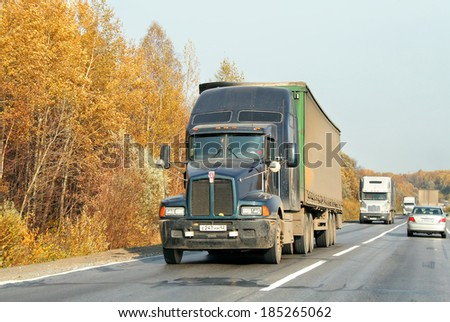 CHELYABINSK REGION, RUSSIA - OCTOBER 4, 2008: Green Kenworth T600 semi-trailer truck at the interurban road. - stock photo