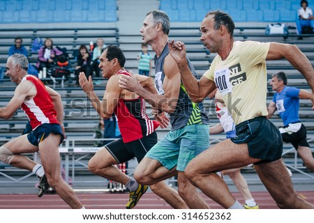 Chelyabinsk, Russia - August 28, 2015:  competition old men athletes at the distance of 100 meters during championship of Russia athletics among the elderly, Chelyabinsk, Russia - August 28, 2015 - stock photo