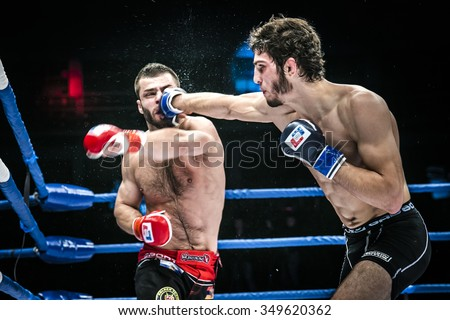 Chelyabinsk, Russia - December 5, 2015: final battle MMA fighters kick hand to head. splashing water and sweat during Cup of Russia MMA - stock photo