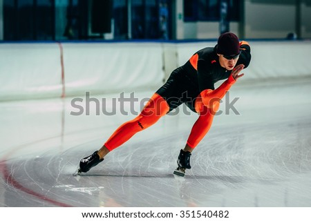 Chelyabinsk; Russia - December 3; 2015: young man athlete skater warming up before race sprint distance during Cup of Russia on speed skating
