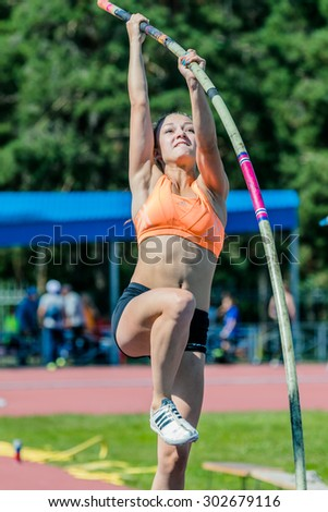 Chelyabinsk, Russia - July 24, 2015: closeup young woman athlete jumping pole vault, during National competitions in memory of G. I. Nicewhen athletics - stock photo