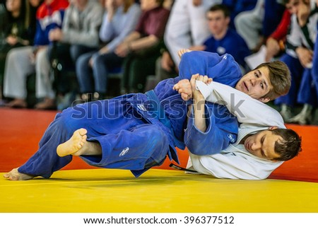 Chelyabinsk, Russia -  March 19, 2016: two fighters fight wrestlers during Russian competition on judo - stock photo