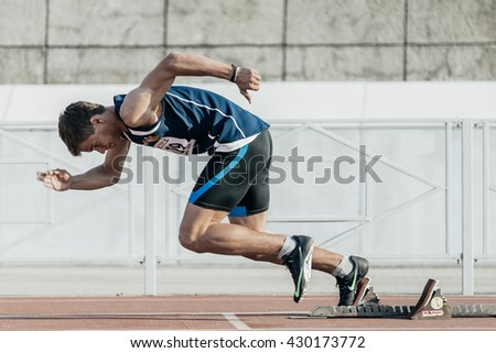 Chelyabinsk, Russia - May 24, 2016: male runner starts from starting blocks on a distance of 400 meters during UrFO Championship in athletics - stock photo