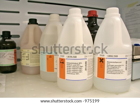 Chemical bottles on wet bench in the lab - stock photo