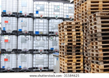 Chemical container and wooden pallets - stock photo