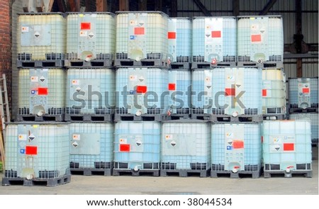 Chemical container in a warehouse - stock photo