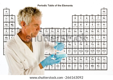 Chemical engineer or doctor with laboratory equipment in front of a Periodic table of elements - stock photo
