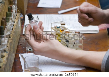 Chemical experiment at the laboratory - stock photo