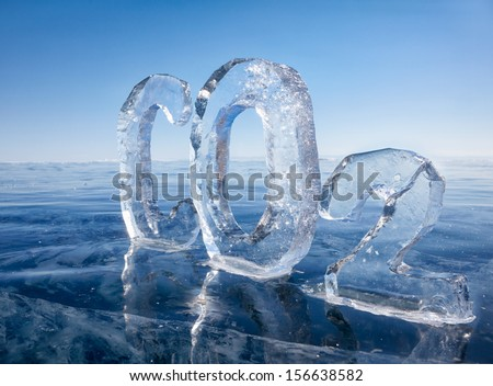 Chemical formula of greenhouse gas carbon dioxide CO2 made from ice on winter frozen lake Baikal under blue sky  - stock photo