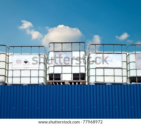 Chemical IBC container on an industrial site - stock photo