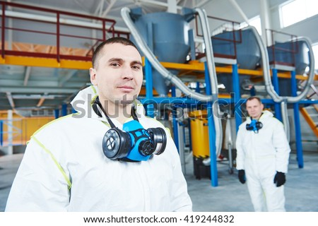 chemical industry workers at factory - stock photo