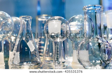 Chemical laboratory glassware. Abstract background. Shallow depth of field. - stock photo