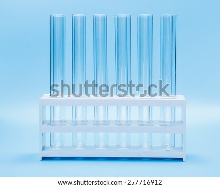 Chemical laboratory glassware: empty test tubes in rack - stock photo