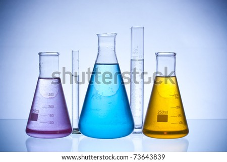 chemical laboratory glassware equipment with color liquid - stock photo