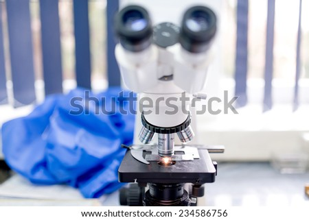 Chemical laboratory microscope, tools and gadgets. Scientific and health care research equipment - stock photo