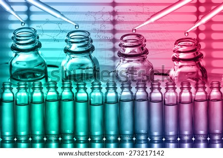 Chemical Laboratory,scientist dropping the reagent into test flask - stock photo