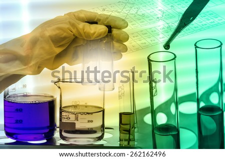 Chemical Laboratory,scientist dropping the reagent into test flask and tube