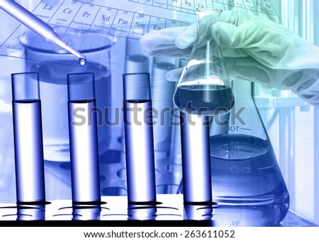 Chemical Laboratory,scientist dropping the reagent to test tube