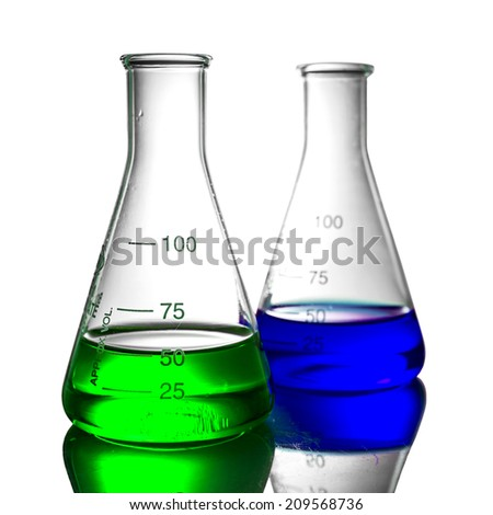 Chemical liquid in flask with reflection on white background - stock photo