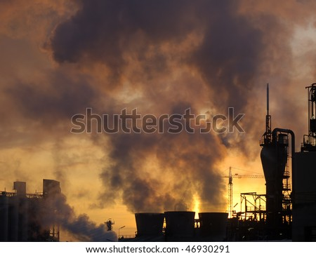 Chemical plant air pollutions with black clouds of smoke - stock photo