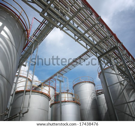 chemical plant and storage tanks, sunny day