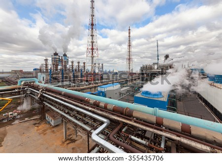 Chemical plant for production of ammonia and nitrogen fertilization on day time.  - stock photo