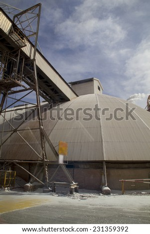Chemical plant.Potassium ready for transportation by conveyor - stock photo