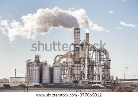 Chemical plant. Silos and smokestacks of a factory. - stock photo