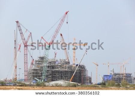 Chemical plant under construction with big crane