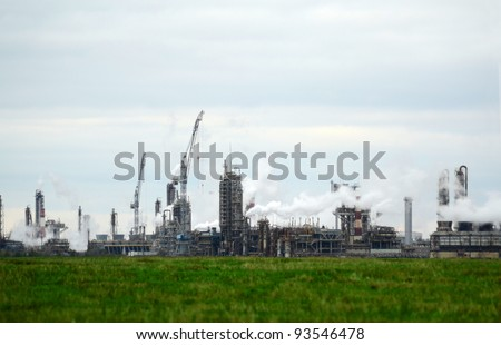 Chemical plant with smoking pipes - stock photo