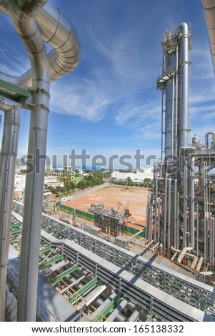 Chemical refinery tower in sunny day