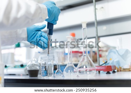 Chemical scientist working in modern biological laboratory - stock photo