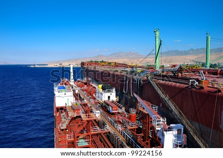 chemical tanker during unloading operation ship to ship - stock photo
