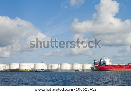 chemical tankers in amsterdam harbor - stock photo