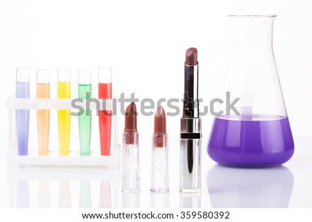 chemical test tubes and lipstick. harmful cosmetics. - stock photo