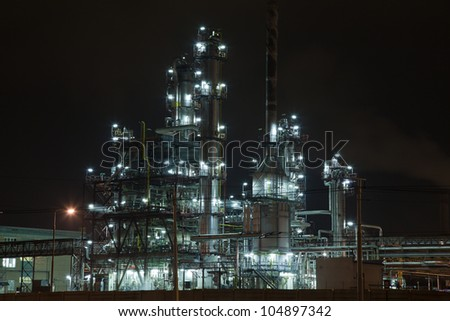 Chemical unit with piping and distillation columns - stock photo