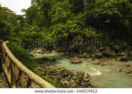 Chemicals contained within two merging rivers creates the beautiful blue color of Rio Celeste. - stock photo