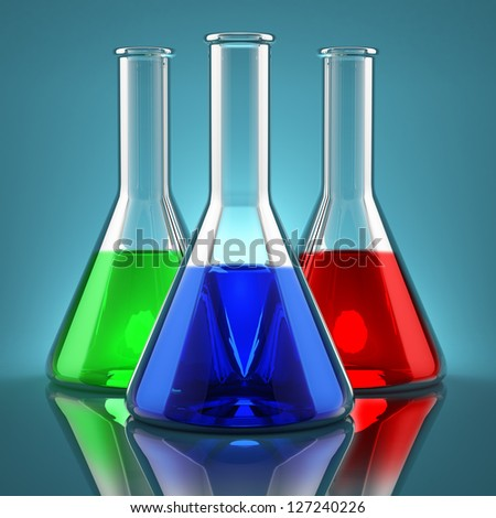 Chemicals of different colors in laboratory flasks - stock photo