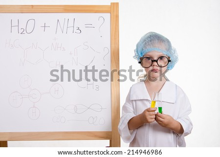 Chemist girl in points and with the tubes at board - stock photo