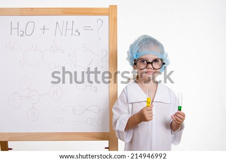 Chemist in points and with two tubes at board - stock photo