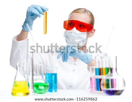 Chemist in respirator holds a vial with orange liquid, isolated on white